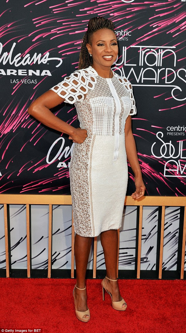 Mesh and a zipper: Recording artist MC Lyte went with a gorgeous white dress featuring sheer panels with differing patterns and fabric ringlets on the shoulders