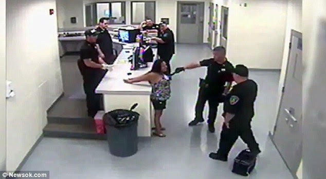 Tasered: The shocking video shows City of McAlester police officer Sterling Taylor-Santino stunning Nakina Williams in the chest