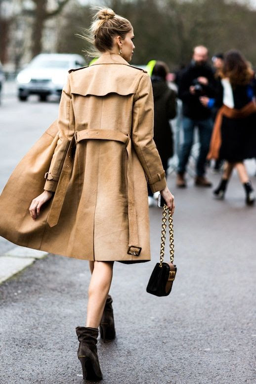 Le Fashion Blog Street Style Elena Perminova Sexy Look Khaki Trench Coat Top Knot Chain Strap Bag Slouchy Heeled Ankle Boots Via Vogue Paris