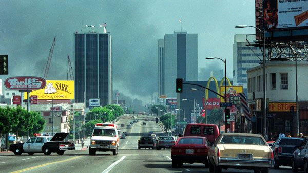 In the distance, Koreatown is enshrouded in smoke during the 1992 Los Angeles riots.