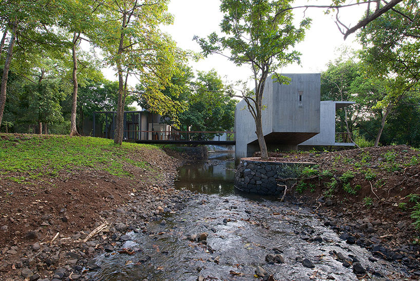 architecture brio weaves retreat house over stream in india