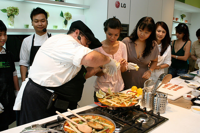 Everyone gets to put the finishing slices of lemon on the paella