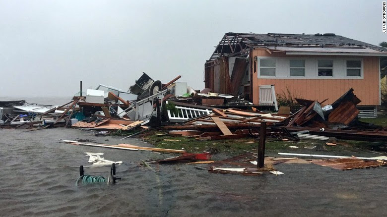 A damaged home sits amid a flood on August 26, 2017, after Hurricane Harvey slammed Rockport, Texas.