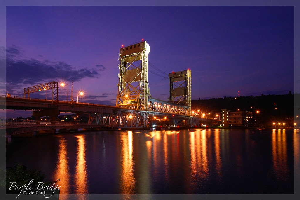 The Portage Lake lift bridge at sunset, with a purple sky.