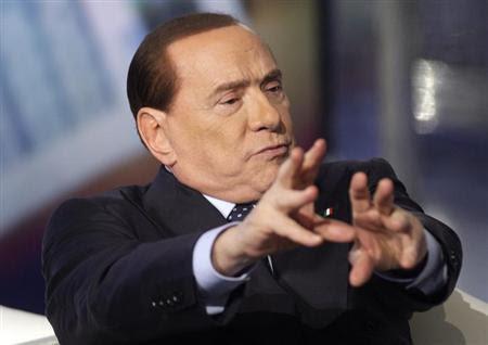 Italy's former Prime Minister Silvio Berlusconi gestures in Rome February 20, 2013. REUTERS/Remo Casilli