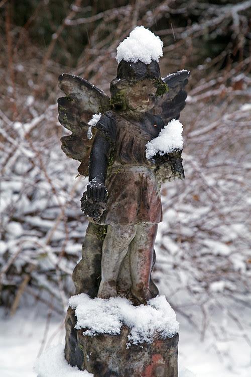snow on angel headstone, Kasaan Cemetery, Kasaan, Alaska