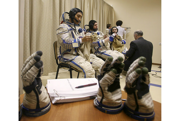 Cosmonauts Sergey Volkov (C) and Oleg Kononenko are joined by South Korean astronaut San Ko (L) during a training session at the Star City space center outside Moscow.