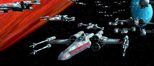 A revamped version of Rebel X-Wing and Y-Wing fighters approaching the Death Star in the STAR WARS: SPECIAL EDITION.