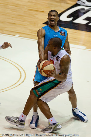 Darryl Hudson is unsuccessful in drawing the charging foul, and has to settle for the block being called - Gold Coast Blaze v Townsville Crocodiles NBL Basketball, Friday 17 December 2010 - National Basketball League, Gold Coast Convention & Exhibition Centre, Queensland, Australia. Photos by Des Thureson.