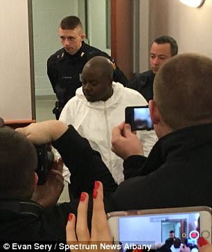 Justin Mann, 24, and James White, 38 (pictured, in white), were arrested in the quadruple homicide that took the lives of two women and two children in their upstate New York apartment