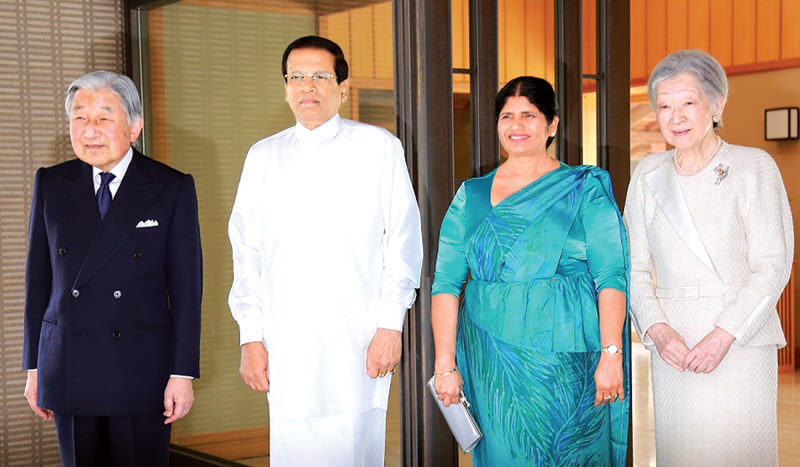 President Maithripala Sirisena and First Lady Jayanthi Sirisena pose with Japanese Emperor Akihito and Empress Michiko upon their arrival at the Imperial Palace in Tokyo yesterday. President Sirisena is on a six-day official visst to Japan. Picture by Sudath Silva