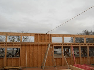 Walls Pulled in Using a Come-Along to Properly Install House Roof Trusses
