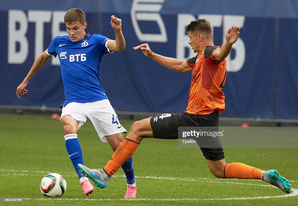http://media.gettyimages.com/photos/roman-zobnin-of-fc-dinamo-moscow-is-challenged-by-alexander-of-fc-picture-id484233180