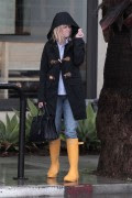 Reese Witherspoon and husband Jim Toth, embraced the rain to say goodbye to her folks. February 28, 2014 x96 HQ's