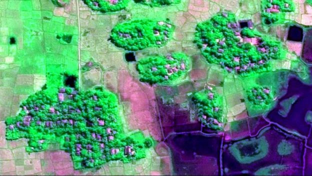 Satellite image showing clusters of structures in a village