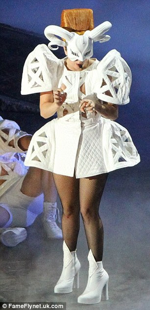 Unusual: Gaga showed off a bizarre futuristic white outfit and a black gothic look as she took to the stage in Bucharest's Constitutiei Square on Thursday night