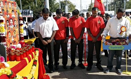 Tamils pay tribute to Tamil victims during a rally in Geneva