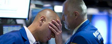 Traders work on the floor of the New York Stock Exchange. (AP Photo/Jin Lee)