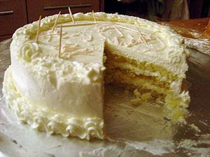 English: Thin layers of a genoise soaked in gr...