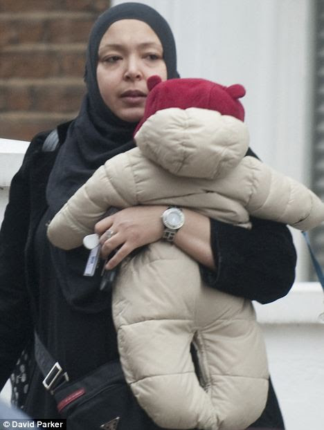 Essma Marjam with one of her six children pictured outside the house in Maida Vale, central London, which costs taxpayers almost £7,000 a month