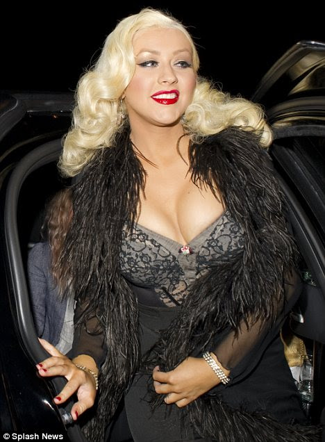 Up front: Christina Aguilera was bursting out of her basque as she arrived to be inducted into Hollywood's Gay Walk of Fame