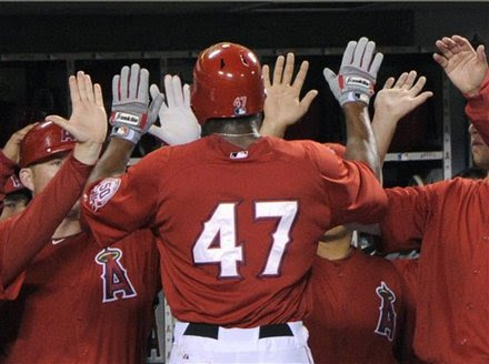 Los Angeles Angels Second Baseman Howard Kendrick, Center, Is