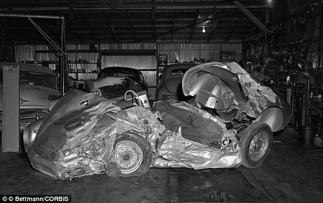 The Porsche gained a reputation for being cursed after reports that those who came into contact with it suffered accidents. Pictured: the wreck in a repair shop in Paso Robles, California, on October 1, 1955