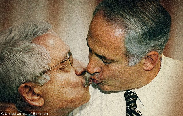 Friendly: This image of Palestian leader Mahmoud Abbas and Israeli prime minister Benjamin Netanyahu kissing will no doubt upset some people in the Middle East