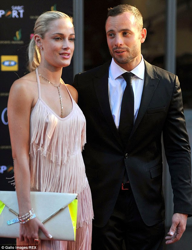 Glamorous couple: Oscar Pistorius with Reeva Steenkamp at the Feather Awards in Johannesburg, South Africa, in November 2012, three months before he killed her