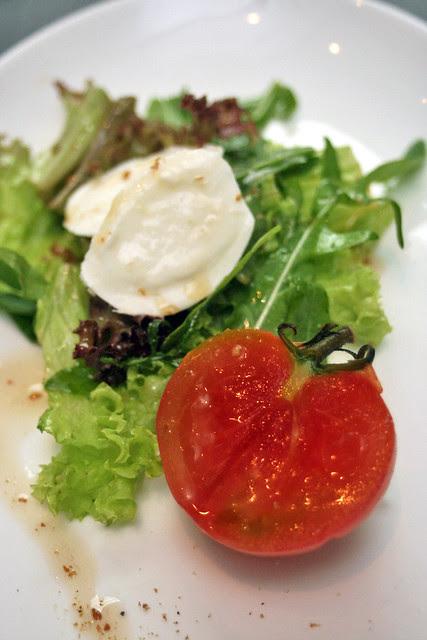 Confit of Tomato Momotaro - basil infused tomato momotaro, mozzarella di buffalo, baby arugula, white sesame vinaigrette, smoked salt flakes