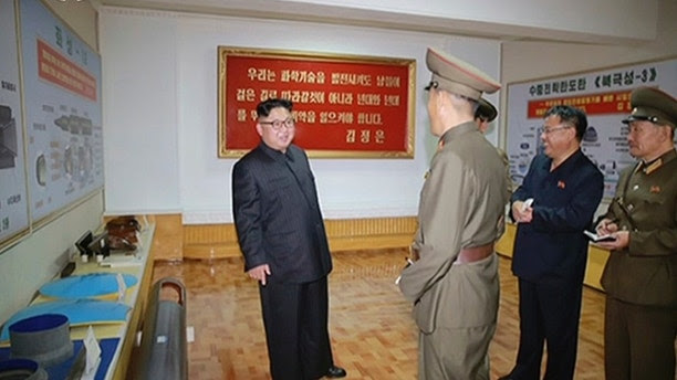 "In this image made from video of a news bulletin aired by North Korea's KRT on Wednesday, Aug. 23, 2017, leader Kim Jong Un visits the Chemical Material Institute of Academy of Defense Science at an undisclosed location in North Korea. North Korea's state media released photos that appear to show concept diagrams of the missiles hanging on a wall behind leader Kim Jong Un, one showing a diagram for a missile called ""Pukguksong-3."" Independent journalists were not given access to cover the event depicted in this photo. (KRT via AP Video)"