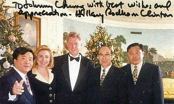 "Chinese-American businessman Johnny Chung (left) with Bill and Hillary Clinton, in a photo signed by Hillary wishing him ""best wishes and appreciation"""