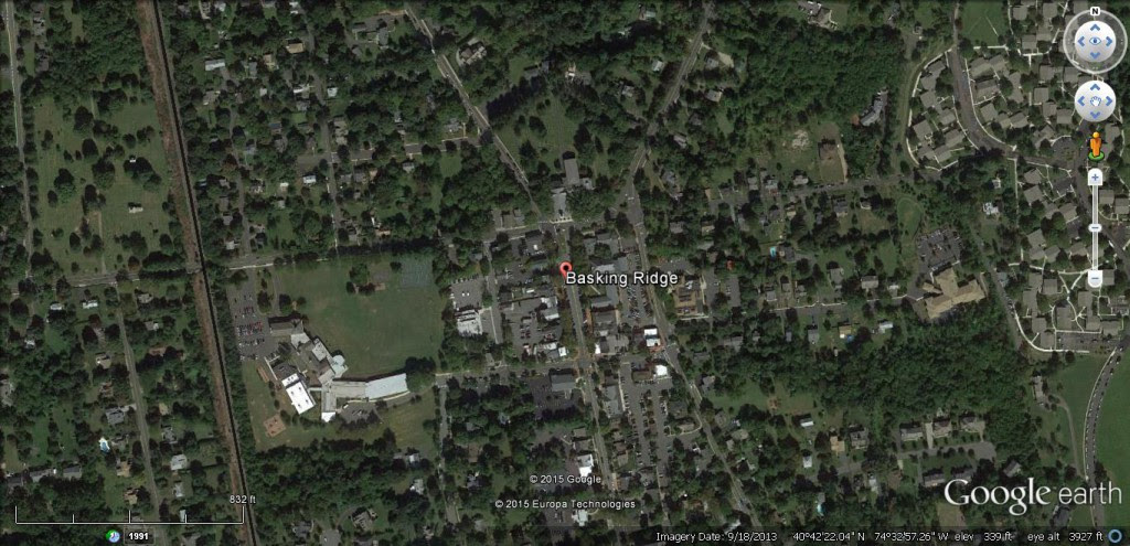 The witness first observed a very large, black triangular object with flashing red, white and blue lights moving over the Basking Ridge, NJ, area. (Credit: Google)