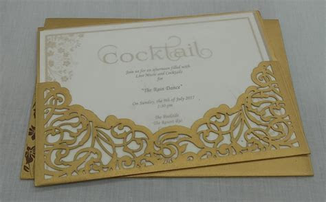 Beautiful golden invite with small brown flowers and cut