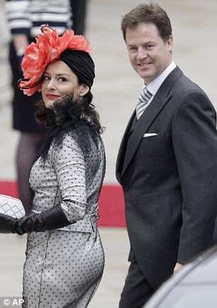 Deputy Prime Minister Nick Clegg and his Spanish wife Miriam, wearing a dazzling polka-dot outfit, arrive for the wedding