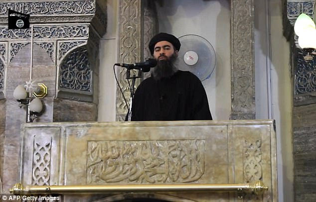 A top Kurdish counter-terrorism official has claimed ISIS leader Abu Bakr al-Baghdadi (pictured in 2014) is alive and hiding in Syria