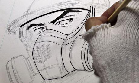 Tatsuta draws the main character in his comic