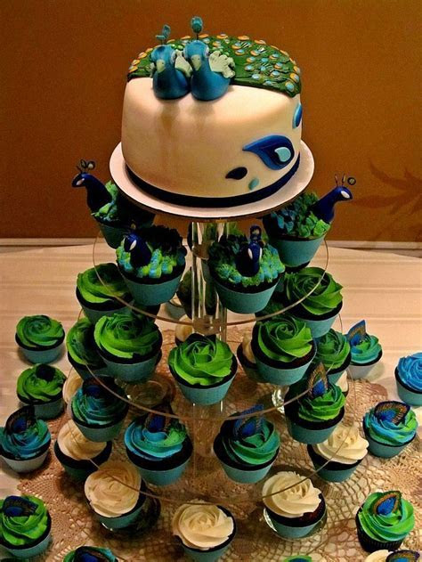 peacock cake with cupcakes   Peacock wedding cake and
