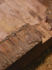 Detail of wooden casing showing guide pin impression