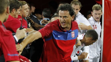 Assistant coach Dejan Govedarica (C) of Serbia attempts to keep the opposing players apart during a scuffle