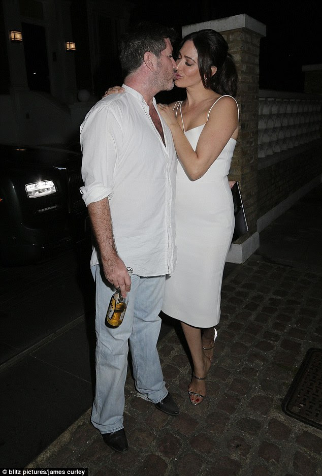 Packing on the PDA: Arriving at the SYCO Summer Party in London at Lancaster House, the 56-year-old music mogul and the American socialite, 38, looked the picture of loved-up as they packed on the PDA