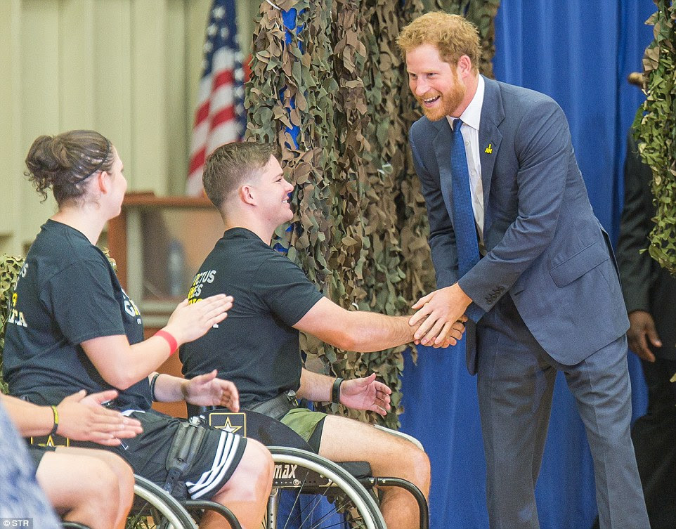 Salute: Prince Harry met members of wheelchair basketball teams at the center. Among them were US Marine Christopher Cowan, 21, from Jacksonville, Alabama, who was lost his leg below the knee in July 2015. 'Doing things like this shows you can still get out there and still compete just the same,' he said