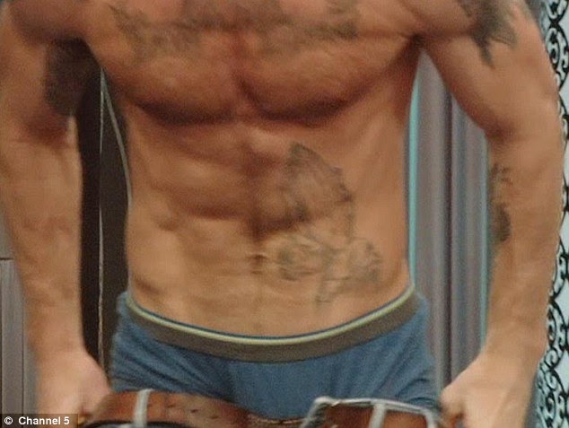 Tattooed: Gareth shows how years on the rugby pitch have shaped his body