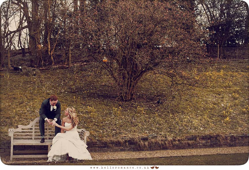 Bride and Groom share a moment on a bench - Bride and Groom Photoshoot - Maison Talbooth Dedham Wedding Photography Essex - Sian and James - Hello Romance Wedding Photography Fun Vintage wedding photography
