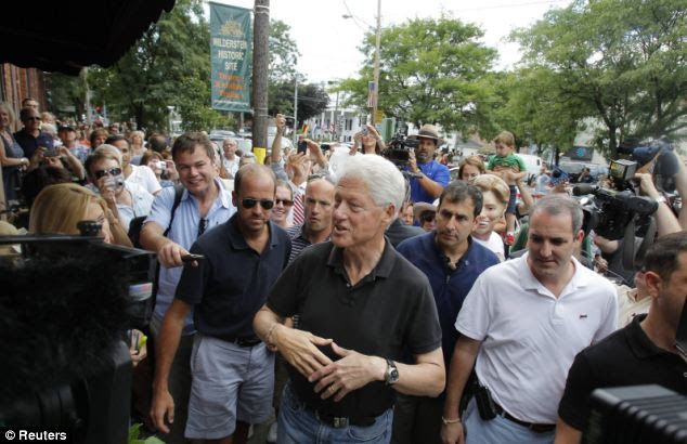 Still pulling a crowd: Bill Clinton in the main street for Rhinebeck yesterday