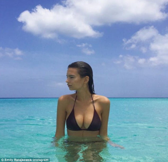 Come on in, the water's lovely: The model posted a series of sexy photos of herself submerged in a glorious blue sea