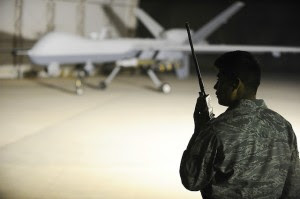Airman 1st Class Hugo Garnica talks remotely to the pilot of an MQ-9 Reaper drone in Iraq, 2008. The Pentagon wants to ensure humans will remain firmly in control of the military's fleet of armed robots. Photo: U.S. Air Force