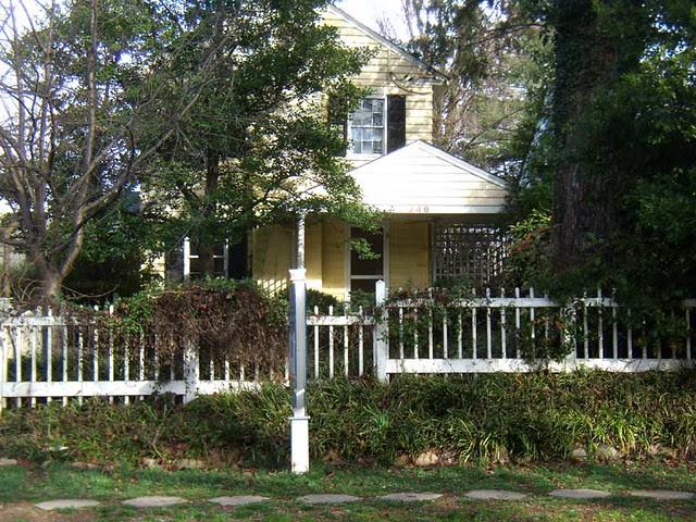 P1071639-Midtown-Sideways-Yellow -Front-Fence 9th street teardown