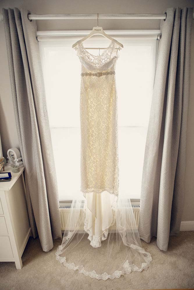 Bride's dress hanging up before wedding - www.helloromance.co.uk