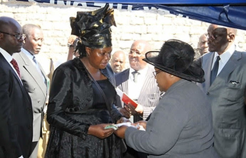 Zimbabwe funeral for Elias Kanengoni, the deputy director of the Central Intelligence Organization (CIO). Vice-President Joice Mujuru consoles the widow of this official. by Pan-African News Wire File Photos